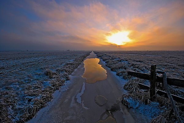 Sonnenuntergang an Graben im Bremer Blockland