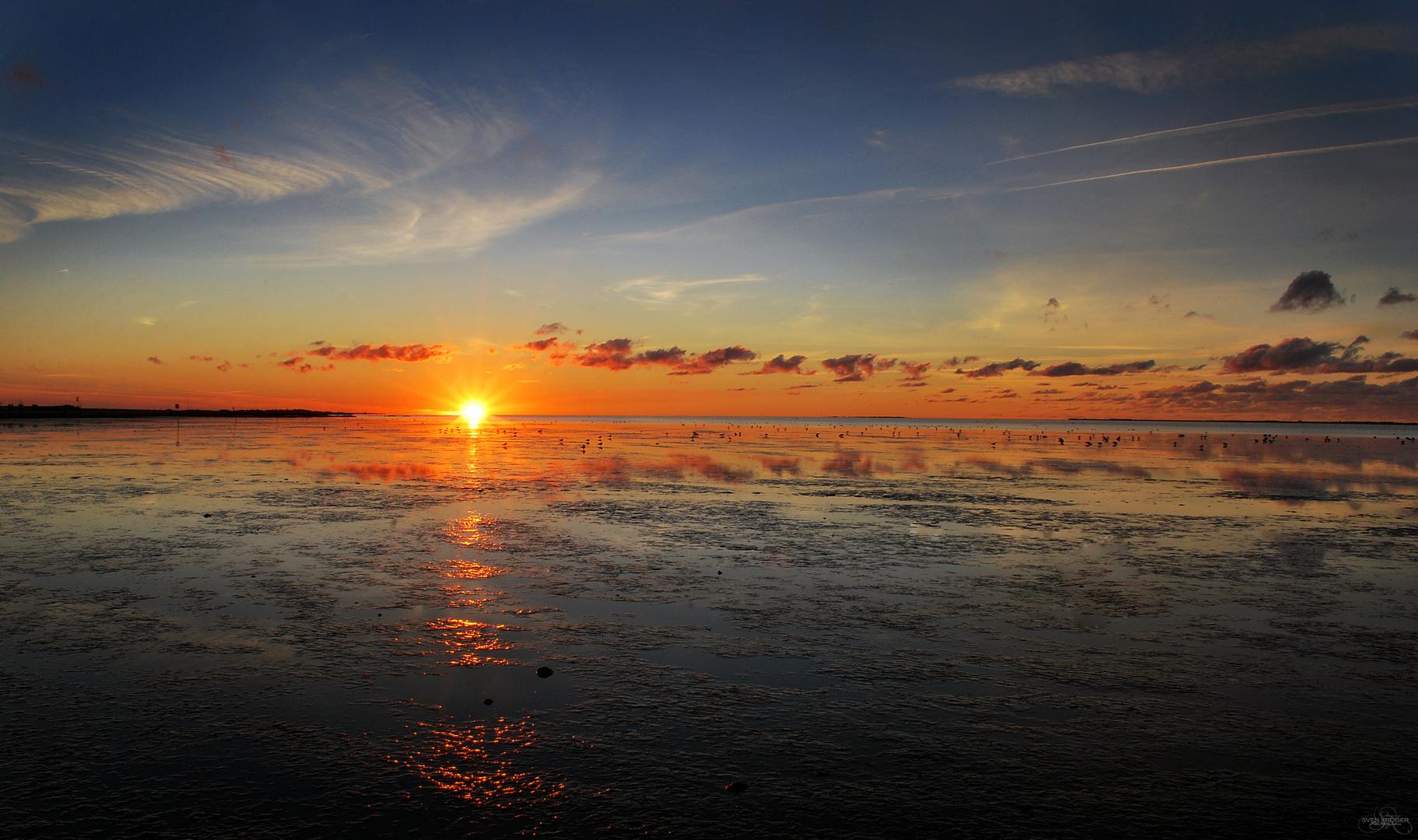 Sonnenuntergang im Wattenmeer bei Harlesiel