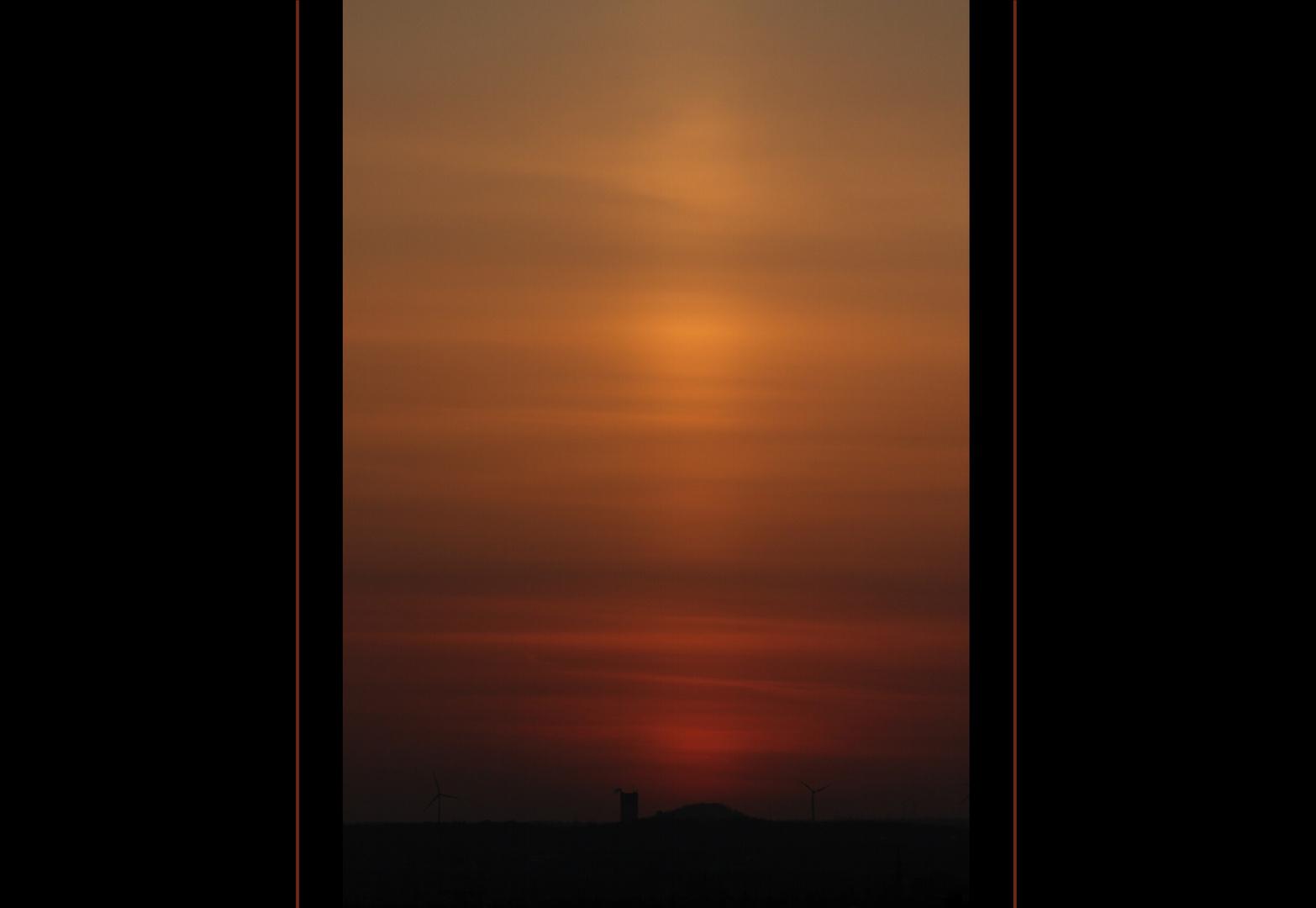 Sonnenuntergang in Aschewolke...