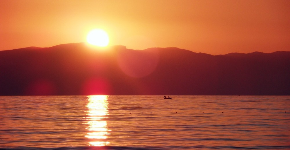 Sonnenuntergang mit Fischern