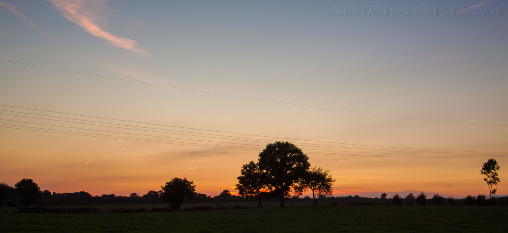 Sonneuntergang über Felder