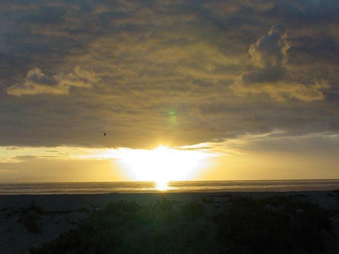 Sonne,Wolken und Meer