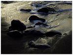 -- stones -- black -- sand --