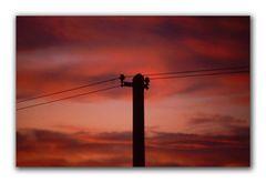 Strommast im Gegenlicht