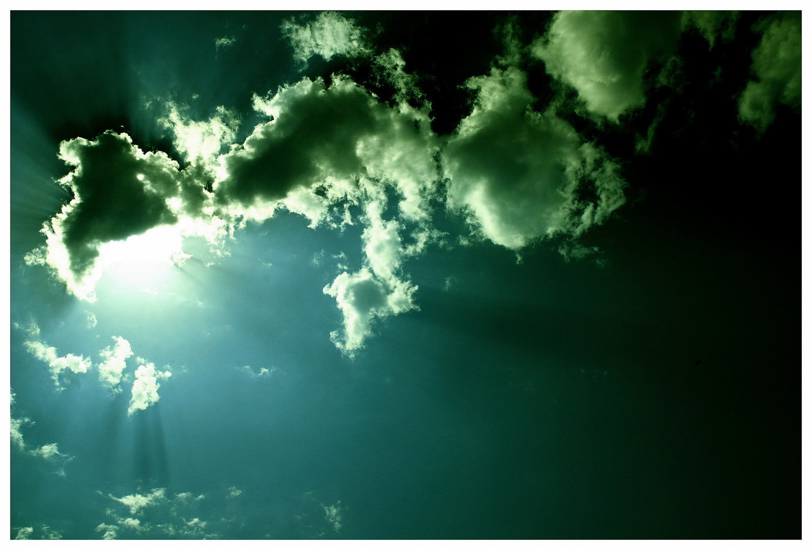 - sun behind the clouds -