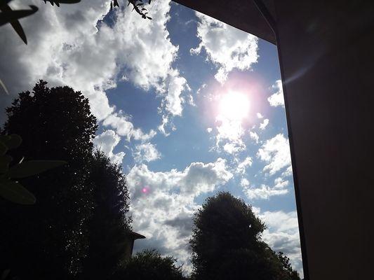Sun under cloud