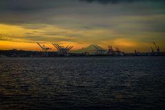 Sunrise behind Seattle and Mount Rainier