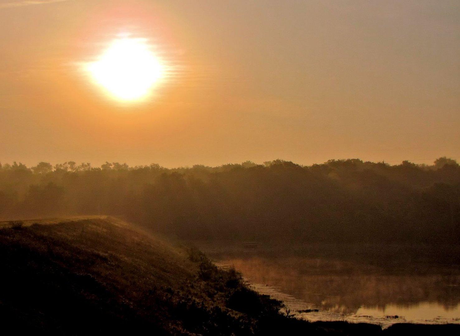 Sunrise Over the Morning Mist