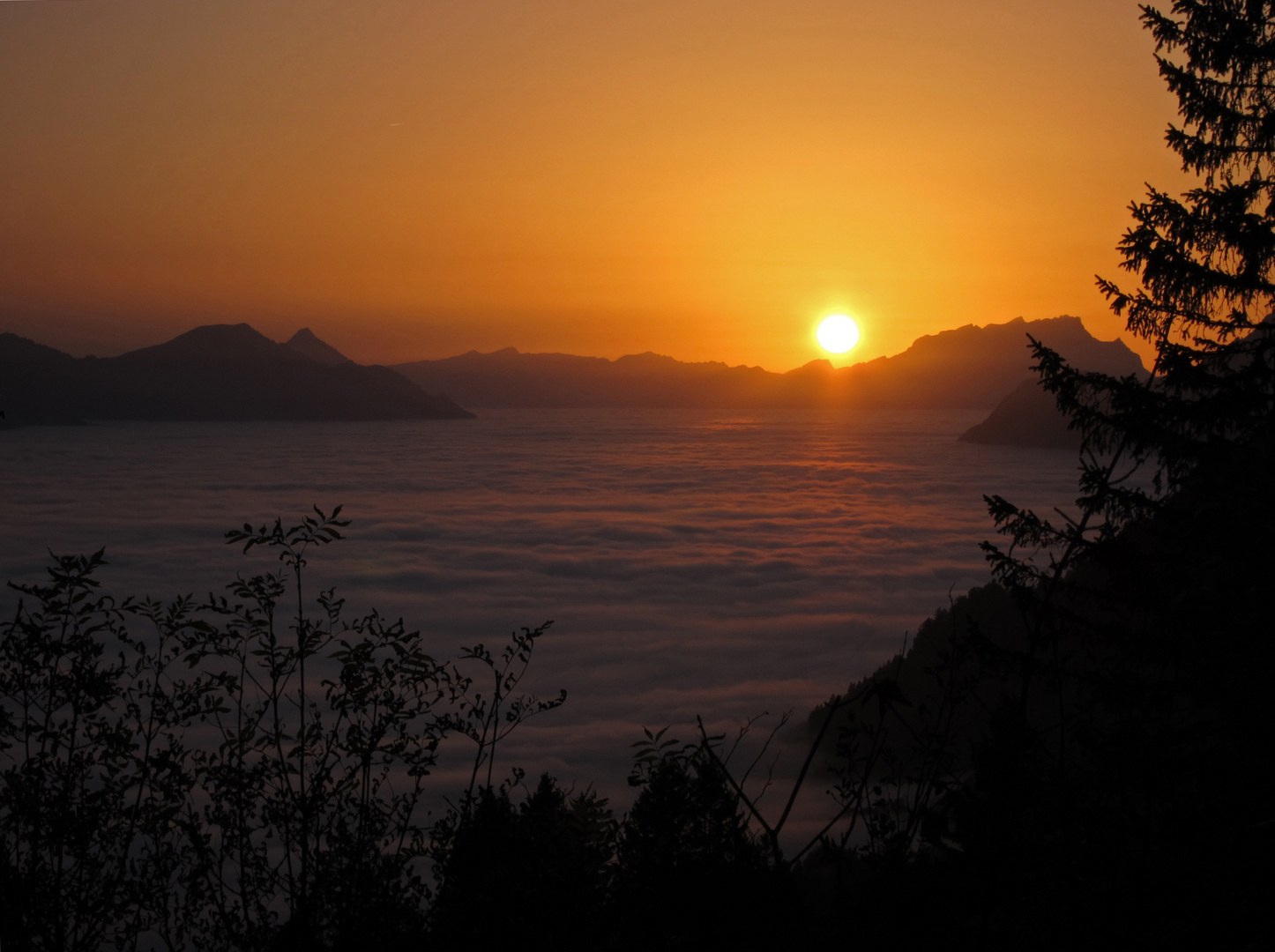 Sunset over a misty Lake Lucerne, Switzerland