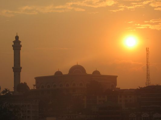 Sunset over a mosque in Uganda