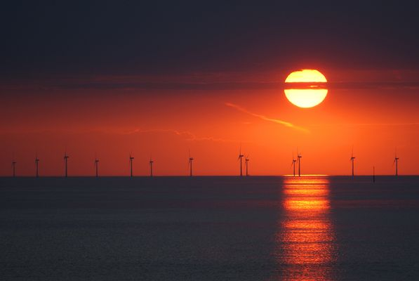 Sunset through Windfarm.