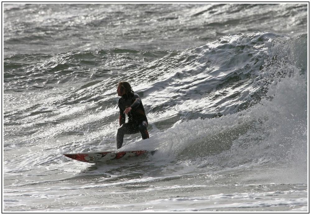 Surfer vor der Welle.