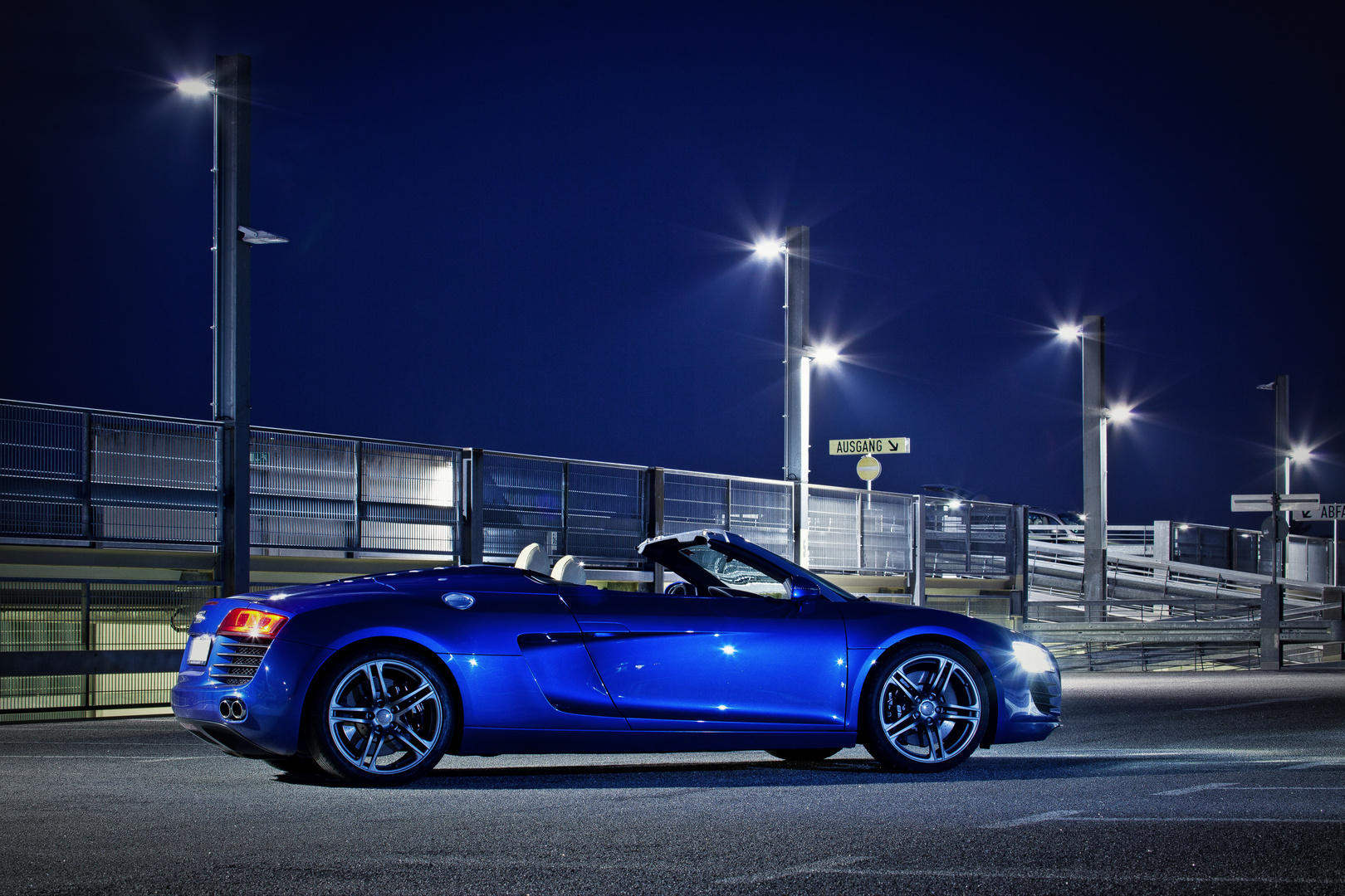 The blue Audi R8 Spyder under the open sky