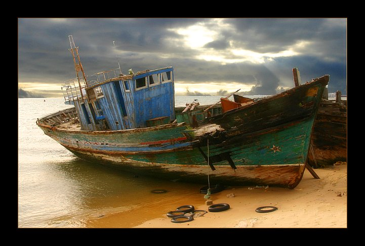 The death of the old boat on beach.