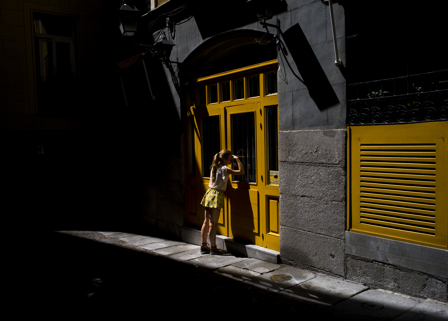 The girl with the yellow skirt.