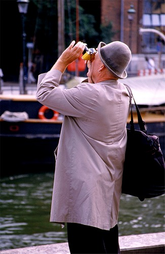 ...the man with the yellow camera...