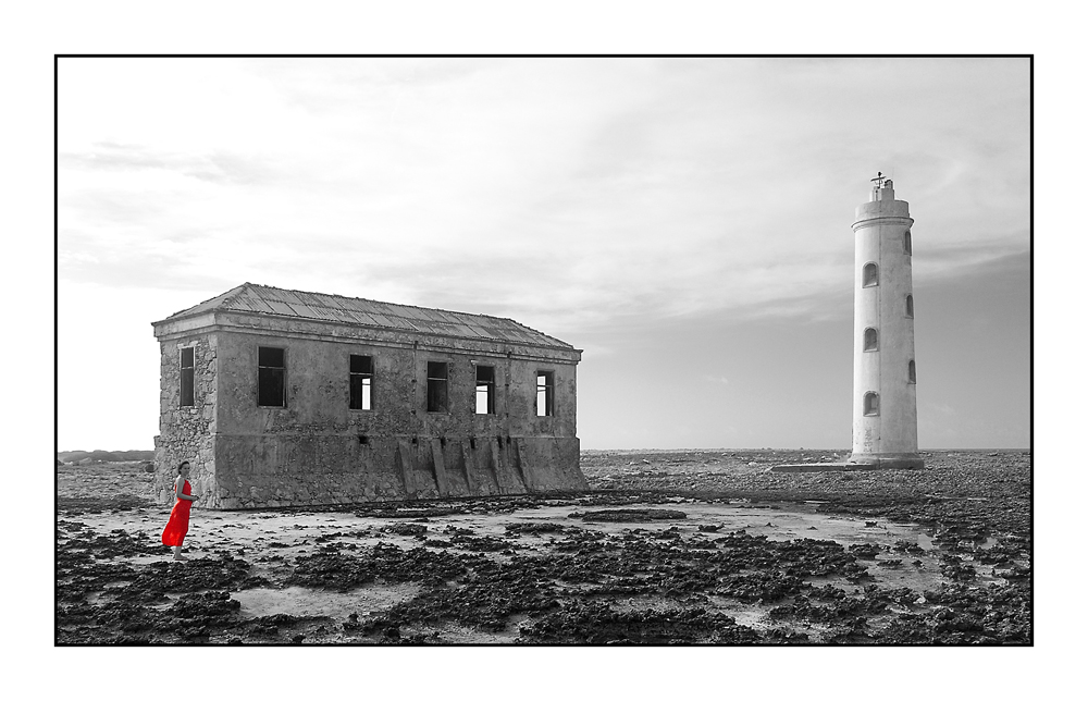 The Old Lighthouse And The Lady In Red