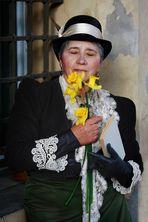 The poet(ess) sniffs a flower