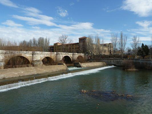 The Roman bridge over Rio Bernesga and Parador San Marcos Leon Spain