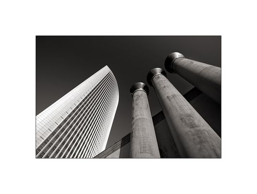 [the skyscraper and the chimneys]