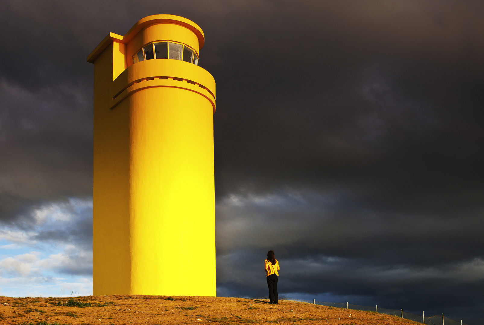The yellow lighthouse and the tourist