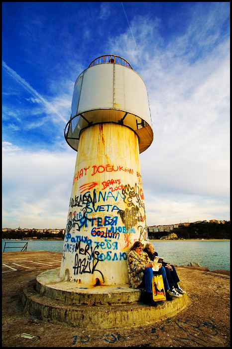 Tourists by the Lighthouse