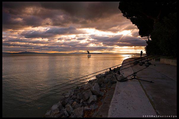 tramonto con pescatore