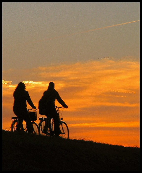 Two girls bicycling home