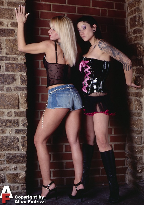 Two girls on wall