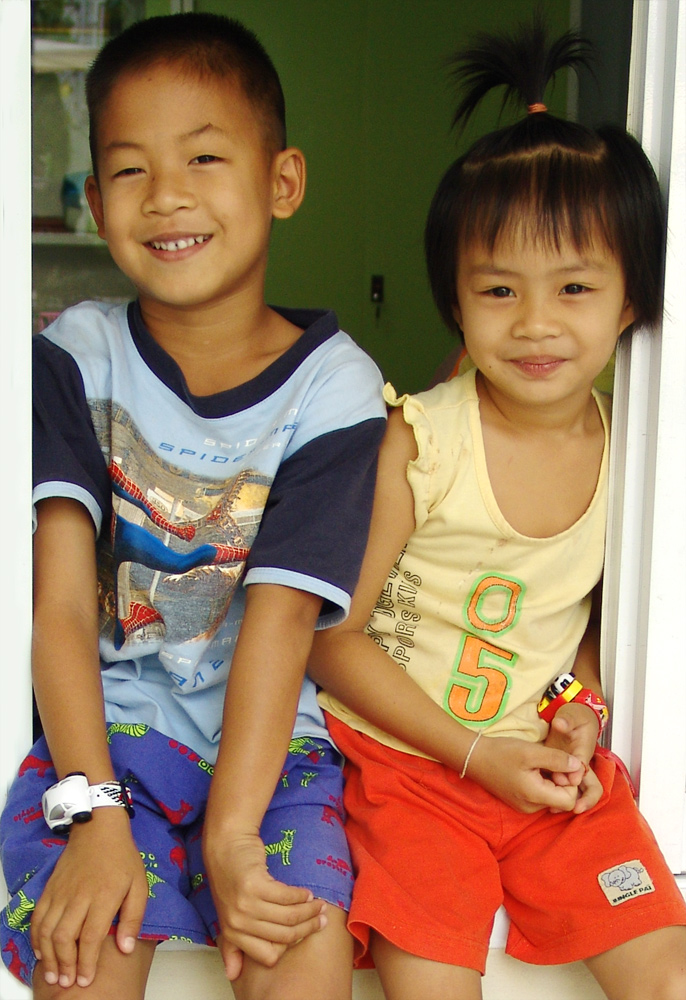 Two Young Isan Kids, Noi & Tarwon, Waiting for Their Parents.
