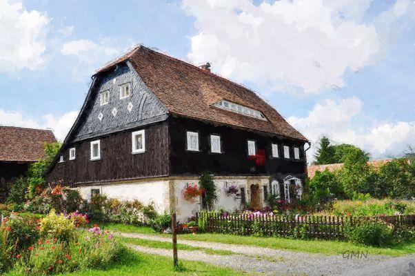Umgebindehaus mit Bauerngarten