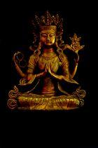 Vierarmiger Buddha vor schwarzemHintergrund, Bronze