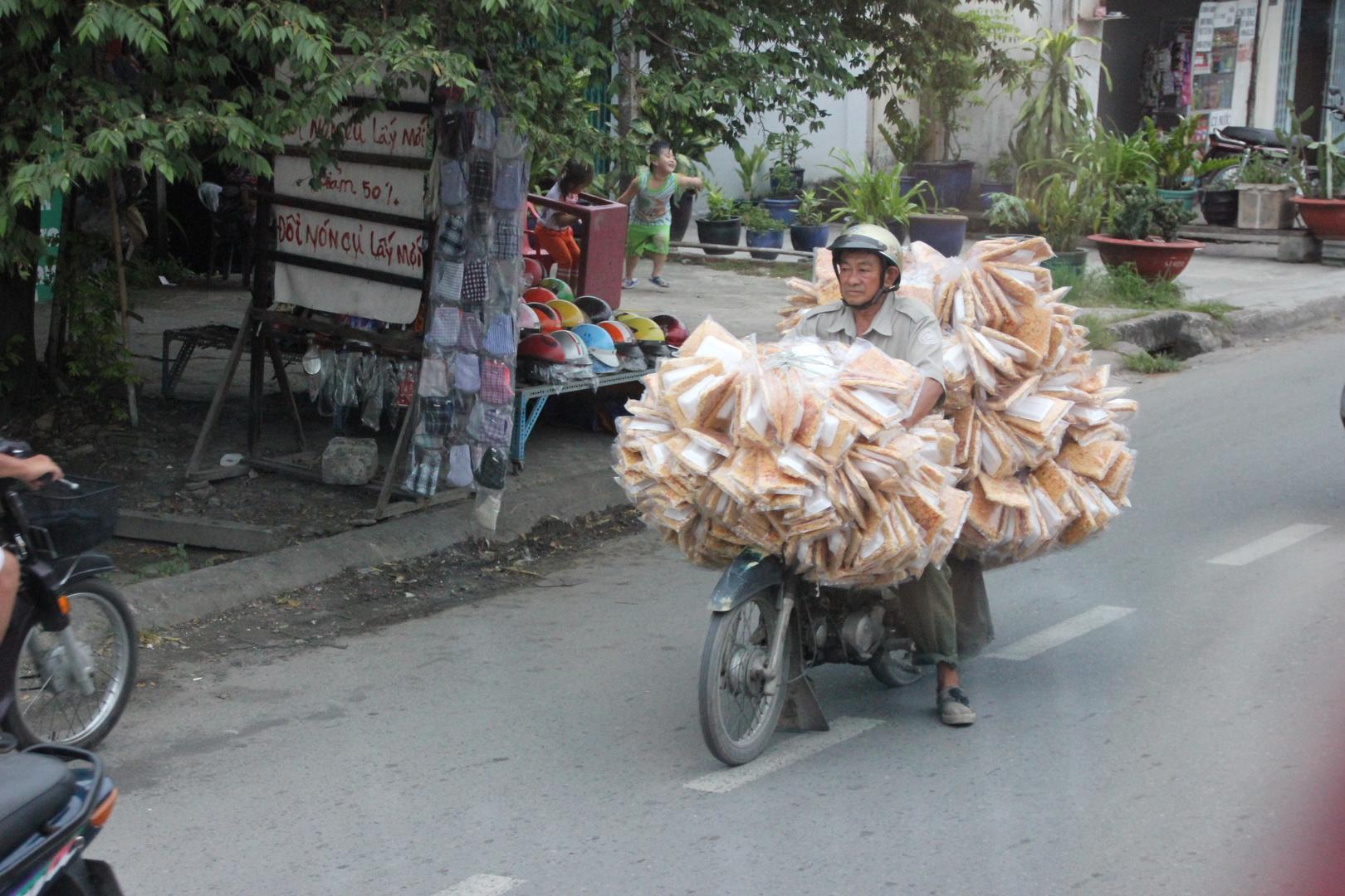 Vietnamesischer Kuchenverkäufer