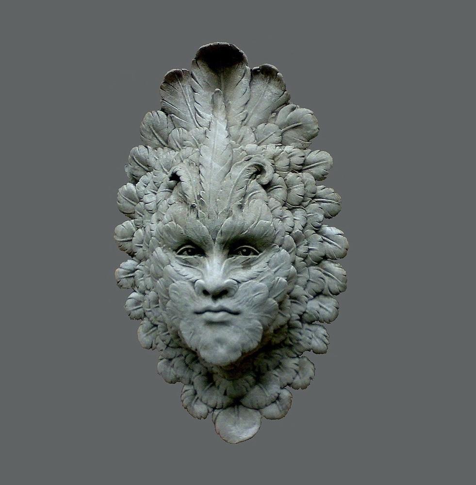 Vogel-Gesicht in Stein