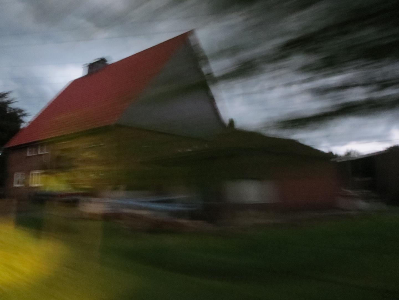 Vorbeieilendes Haus