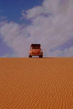 VW-Käfer zwischen Himmel und Erde