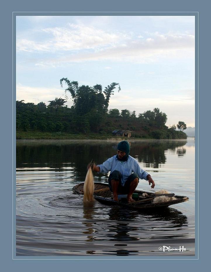 Washing fish net on lake