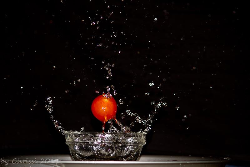 Wasserspritzr und Tomate