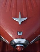 wet red nipple beneath silver airoplan and a V8
