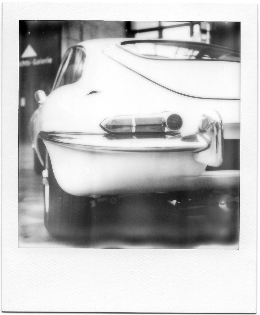 white e-type  Polaroid SX70 / Film impossible