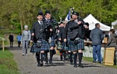Why do bagpipers walk when they play ?