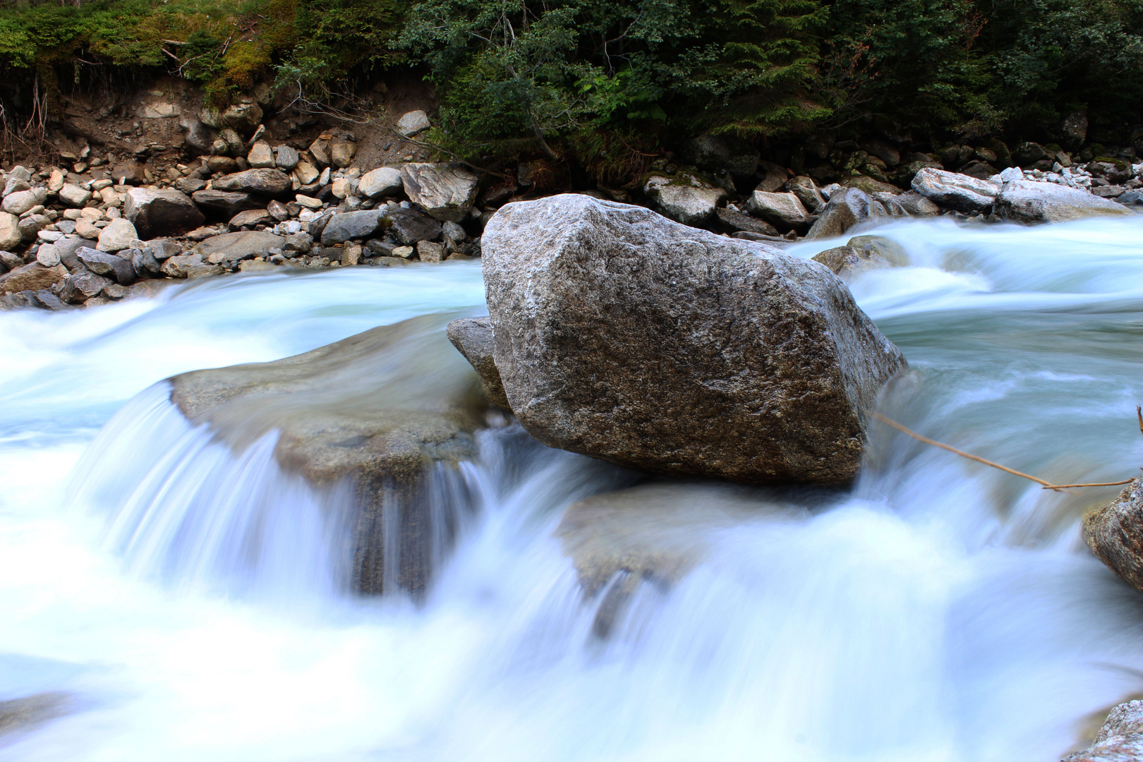 Wild River with a Stone