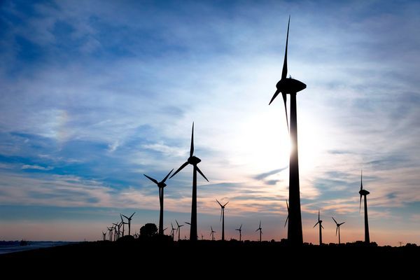 Windmill at the sea near Emden, Germany, Europe