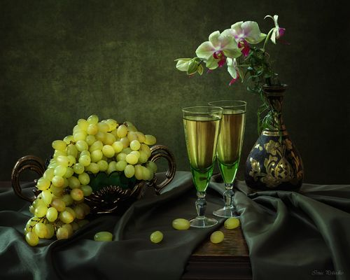 With grapes and orchid