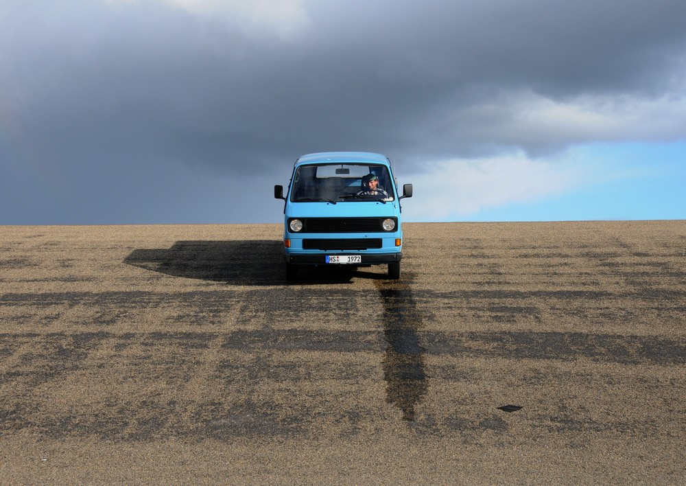 with his vw bus on dike