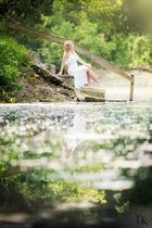 with white dress at the lake