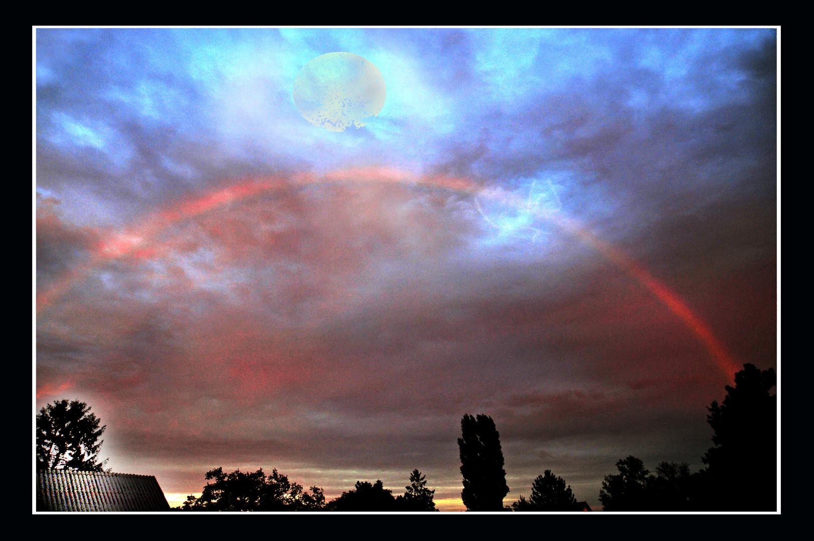 Wolken mit Regenbogen