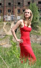 woman in the red dress --- ruins behind