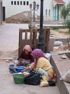 Women Breaking Argan Nuts