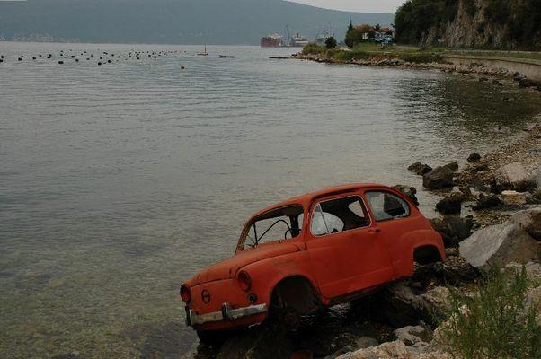 wrecked car at the shore near Bar / Montenegro